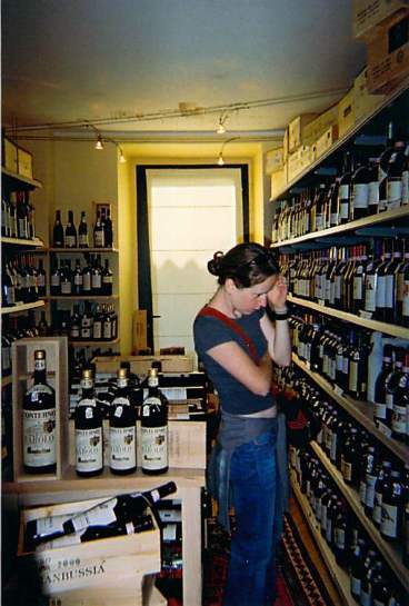 "Me in a Barolo wine shop, 2006 ... ""Sit down. It'll be a while!""  (Thanks to my sister, who took the photo.)"